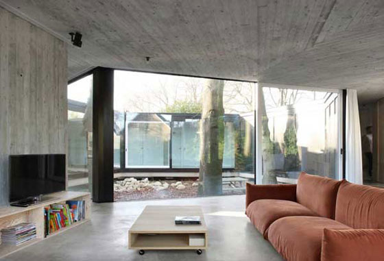 House BM: Multifaceted Concrete House Fully Connected With Nature