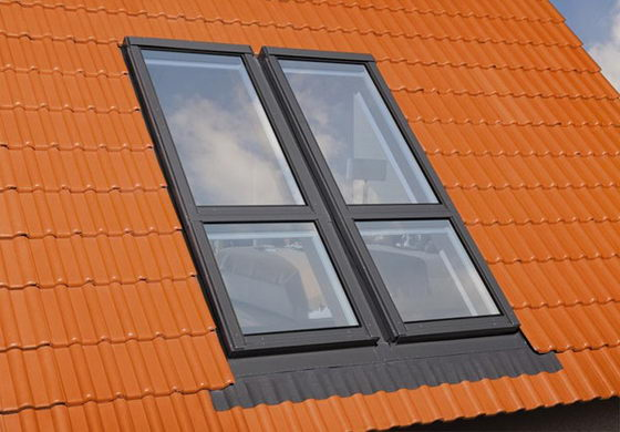 Innovative Window System Adds Small Balcony to Attic Room