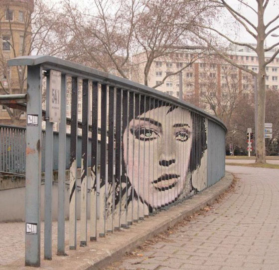 Hidden Street Art on Railings: Only Seen in Perfect Angle