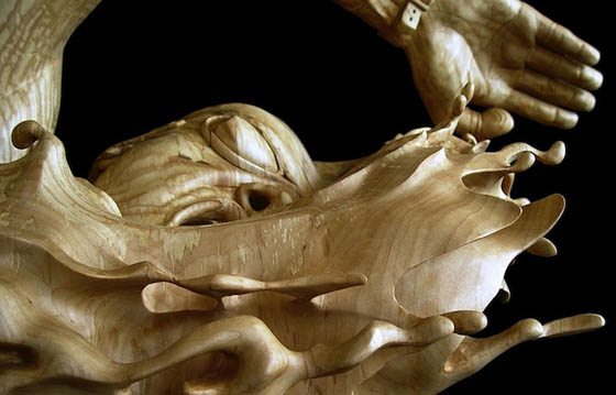 The Swimmer: Stunning Wood Sculpture Carved From a Single Piece of Basswood