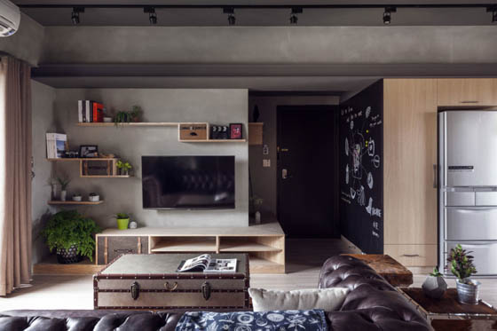 Industrial Style Apartment with Cement Finishes on Walls