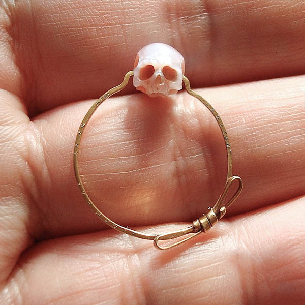 Wearable Sculptures: Anatomical Jewelry Made By Miniature Skulls Carved from Pearls