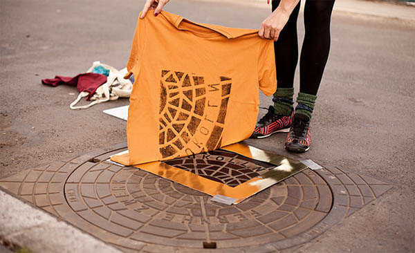 Souvenir T-shirts and Totes Printed Directly From Street Utility Covers