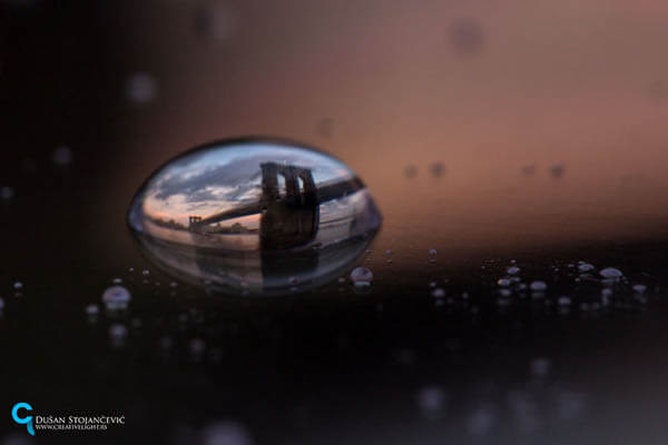 City in Water Droplet by Dusan Stojancevic