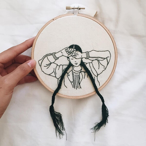 Embroidered Women With Hair Grow Out of Canvas