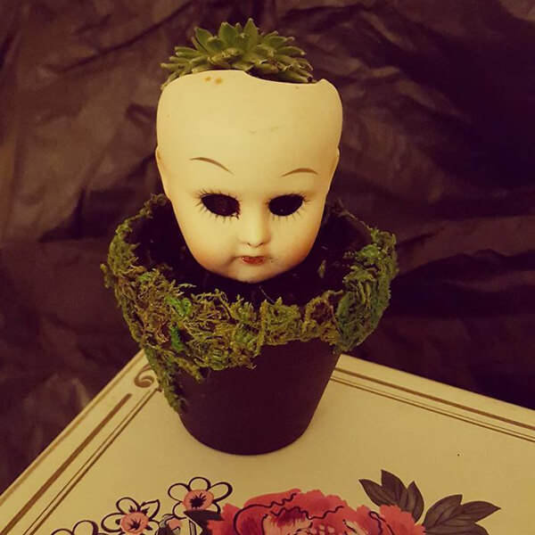 20 Creepy Planter Made Out of Old Dolls
