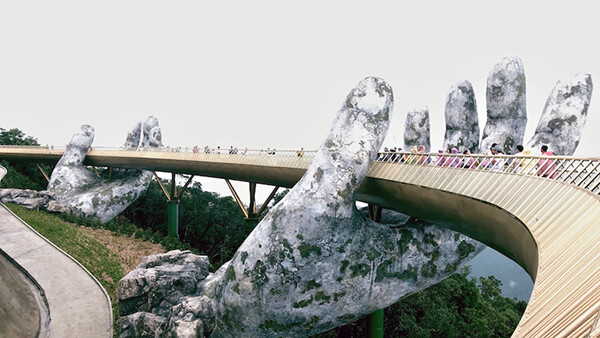 Architecture Wonder: a Pair of Giant Weathered Hands Lift Pedestrian Bridge in Vietnam