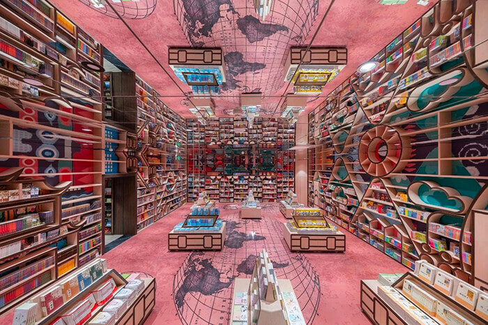M.C. Escher Woodcut Inspired Bookstore With Mirrored Ceiling and Criss-Crossed Stairwells